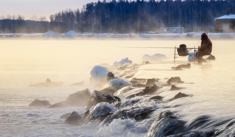Angeln im Winter bringt mit der richtigen Taktik nicht nur Spaß, sondern auch Fisch. Foto: Fotolia