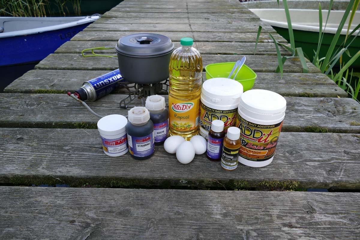 Die Pop-Up Boilie Zutaten auf einen Blick: Öl, Eier, Pop-Up-Basismix, sowie Flavour sind die Grundzutaten. Attraktoren wie Betain, Aminosäuren oder Süßstoff werten die Pop-Ups zusätzlich auf. Foto: karpfen/Sebastian Schmidt