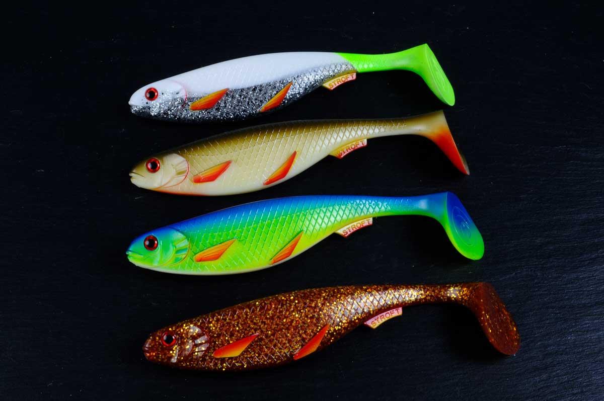Hier sieht man die vier Farben des Gummifisches: Der Silver-Fire Fin (oben), Olive-Fire Fin, UV Blue-Fire Fin und der Motoroil-Fire Fin (unten).